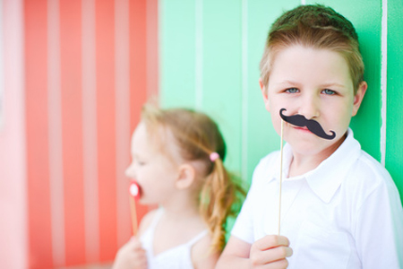 Cute boy with mustache party accessory